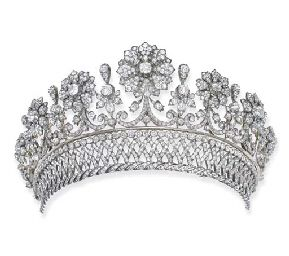 The Palffy diamond tiara by Köchert, Austrian (Vienna), c. 1870. Designed as detachable graduated floral motifs with scroll stems, collet and foliate spacers to the detachable diamond collet, lattice and twisted band, mounted in silver and gold. The Palffy family is of Hungarian nobility.