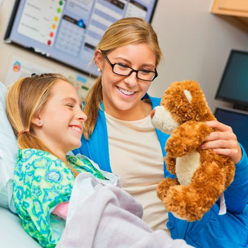 What is a child life specialist? They focus on the emotional, psychological, and developmental well-being of pediatric patients by working to reduce their levels of stress and anxiety. Interested in learning more? Then visit our website by clicking on the image.