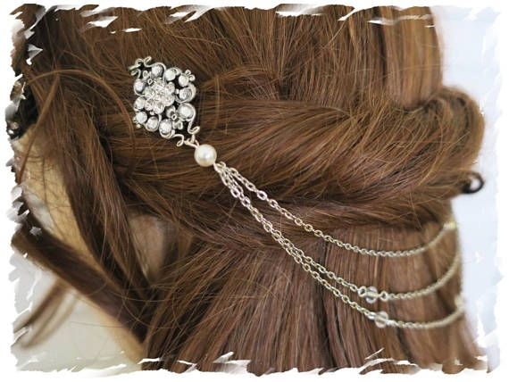 This vintage boho inspired head piece that's equal parts romantic and sophisticated, it is perfect for bridal updos and long loose side swept curls. Its flexible design perfectly frames an updo, loose curls or something in between. Inspired by soft and beautiful botanical details...  Materials* silver plated vintage stampings faceted crystals Swarovski bicone crystals hair pins Swarovski pearls non tarnish silver plated wire Rhodium chain  Measurement* The brooches are 2 inches The brooches…