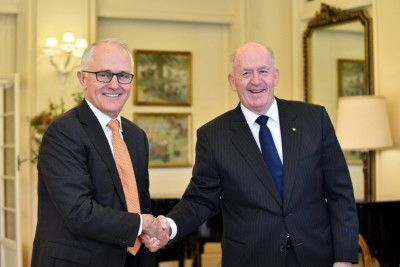 The Prime Minister of Australia and the Governor-General of Australia, Sir Peter Cosgrove shake hands at Government House in Canberra. Picture: Michael Masters/Getty Images