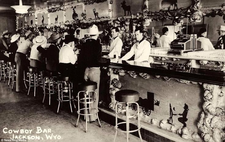 The Cowboy Bar in Jackson, Wyoming, 1908. During the late 19th and early 20th century saloons were an ever-present feature in American frontier towns. Over time they developed into sleekly designed affairs, as seen here in Wyoming