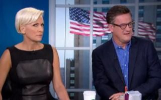 Men Of Morning Joe Give Mika Brzezinski A Tough Time For Her 'Catwoman' Outfit  i guess joe has not much to complain about so he pics on mika... a slow day for joe.. ha ha