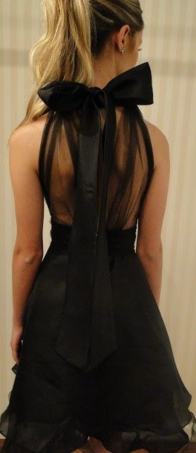 The Philadelphia Story: The Millionairess of Pennsylvania: stunning bow black evening gown.