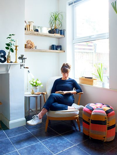 Credit: Ingrid Rasmussen Murphy sits in a vintage Ercol armchair (try eBay); the table lamp behind her is ­Hector by ­Original BTC. She uses her own fabrics at home, but the brightly coloured pouffe is from Liberty.