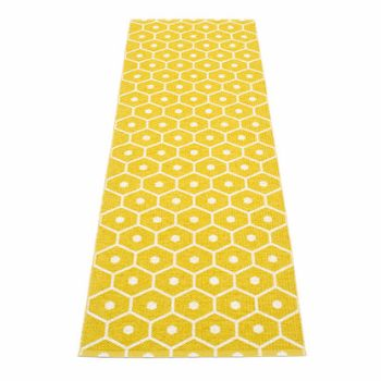 Pappelina Honey Mustard Runner - 70 x 225 cm: Woven from soft plastic using traditional Swedish techniques, they can be used in all areas of the home, and even outdoors. They are reversible, dust and dirt repellent, and fully washable, although a quick vacuum is probably all they will ever need to keep them looking good as new.