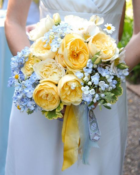 Yellow garden rose and blue tweedia bouquet