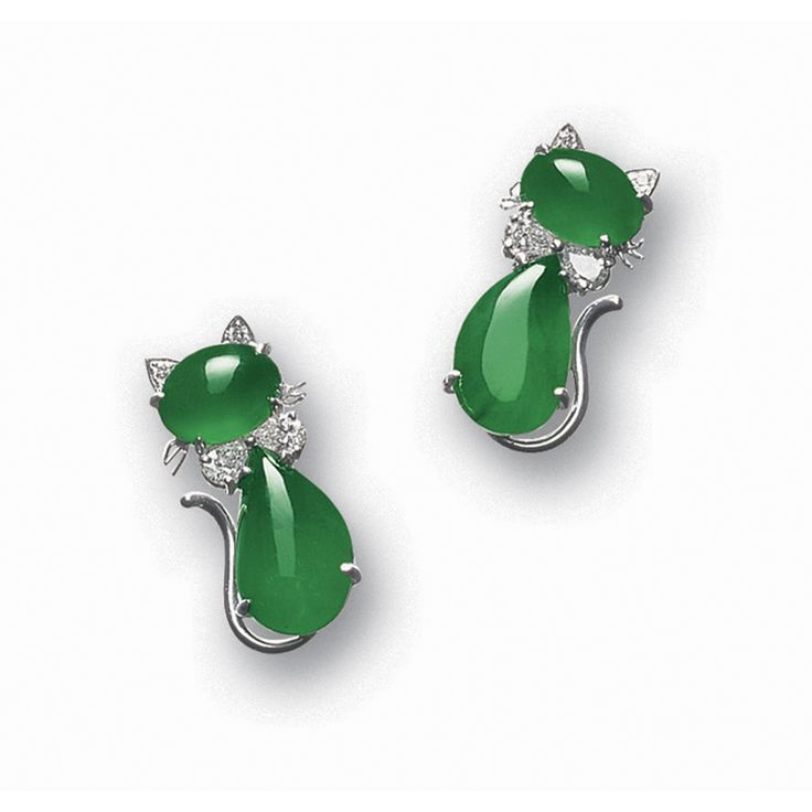 PAIR OF JADEITE AND DIAMOND 'CAT' EARRINGS Each head and body set with an oval and a pear-shaped jadeite cabochon, wearing a bow-tie composed of two pear-shaped diamonds, enhanced by diamond-set ears and a curved tail, mounted in 18 karat white gold.