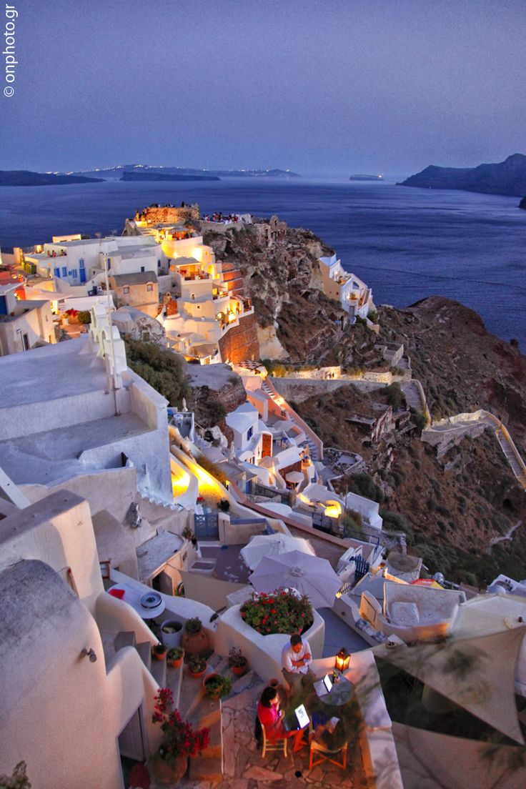 Santorini. Warm colours of sunset and a breathtaking view!