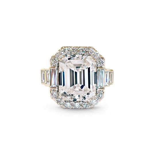 The Allure Emerald Cut Engagement Ring by Scout Mandolin is structural and modern. Set alongside elegant pave diamonds and straight baguettes, the emerald cut center stone shimmers with the utmost fire. Perfected with expert craftsmanship, the geometrical design under the ring allows light to shine through.  #engagementrings