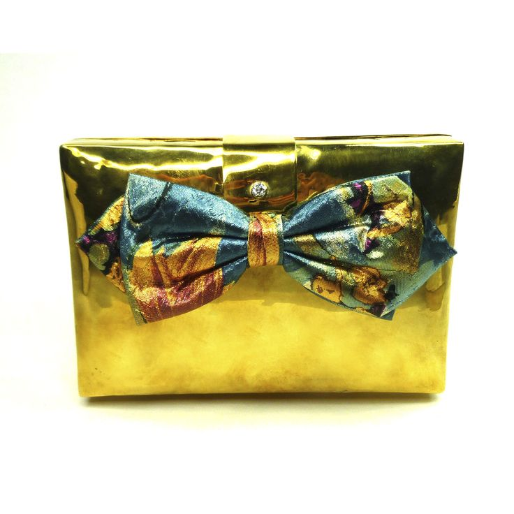 Leya clutch made from a bomb shell. Handcrafted in Cambodia.
