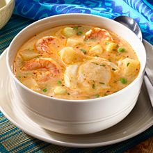 Chupe de Camarones or Peruvian-Style Shrimp Soup is seasoned with tomatoes and spiked with a touch of hot red peppers, and then thickened with starchy vegetables, like large-kernel corn, yuca and potatoes, and finally rice.