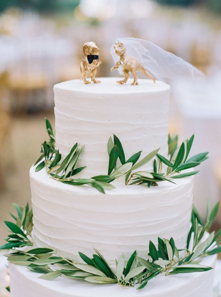 The bride and groom dinos were a fun addition to this Sablée wedding cake.