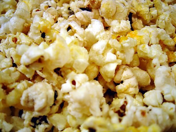 Garlic Butter & Cheese Popcorn   This is a gourmet popcorn that may make you want to pop a second batch, even though you've eaten enough! Adapted from Moosewood Restaraunt New Classics cookbook.