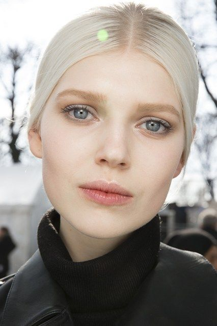 Backstage Beauty: Autumn/Winter 2014 - Valentino/ Pat McGrath created a youthful, illuminated look at Valentino, with subtle grey liner around the eyes for definition.