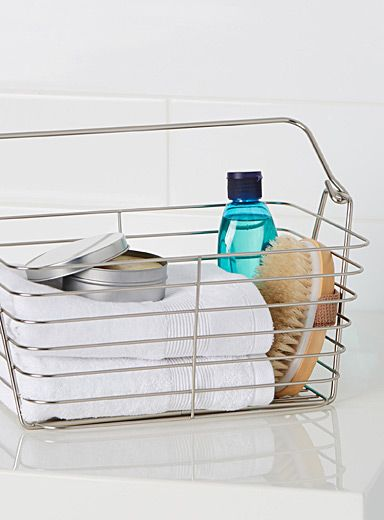 - Perfect for storing face washers and towels in the bathroom - Practical size with a carry handle - Openwork wire construction with a chic chrome finish - 31 x 19 x 25 cm