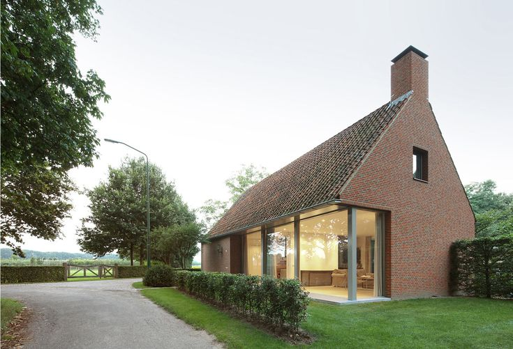 Dutch firm Bedaux de Brouwer Architecten recently completed House Berkel-Enschot, a brick structure that connects to an old, existing barn.