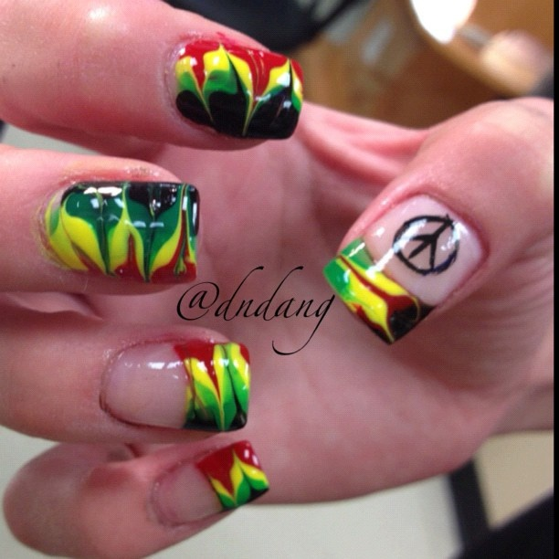 Pretty rasta nails with a peace sign
