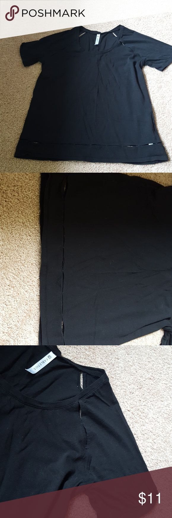 Sz. S fabletics black vented workout shirt This is made of a lightweight cotton material that breathes well while you work out. It has  a vented,  open hole design around the bottom of the shirt and around the arms. There are closer pictures shown above. It was only worn one or two times and is in very good used condition from a smoke-free home. Fabletics Tops