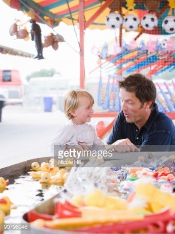 father and son at a carnival