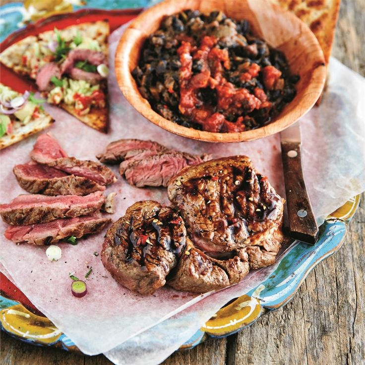 Regular old steak with a Mexican twist: Serve in thin slices with guacamole and beans on tortillas.
