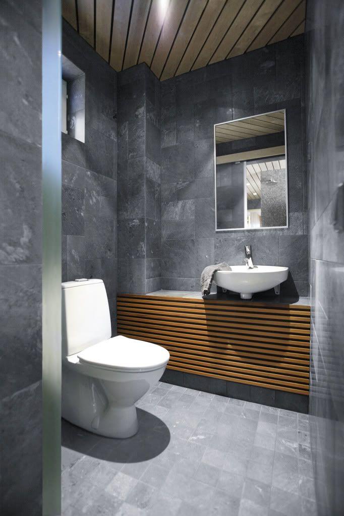 dark wall stones in cute modern bathroom design