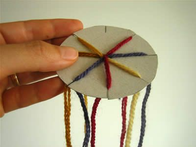 tutorial how to use cardboard wheel to make friendship bracelets  video here http://www.youtube.com/watch?v=YhHclB7W4q8