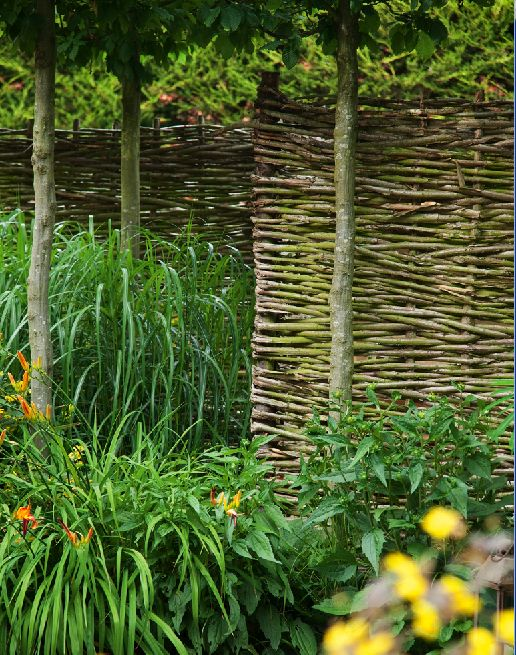 Here, hazel has been woven around upright poles of chestnut, which have been cemented into the garden for extra strength. Made from coppiced wood in the UK, these kingds of screens are a better ecological choice than chemically treated softwood panels.