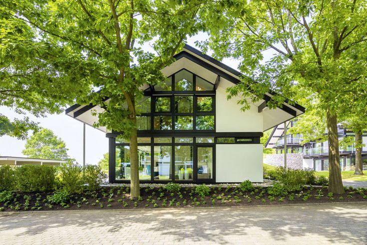 Present Day Timber Residence With Glass Facade By Huf Haus, Germany - http://www.295luv.com/home-design/moderncontemporarymodern-daypresent-day-timber-househomeresidenceproperty-with-glass-facade-by-huf-haus-germany.html