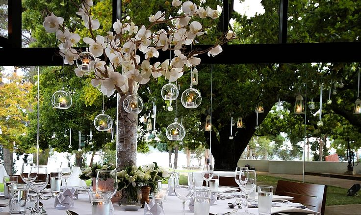 Beautiful and creative wedding table centrepieces. wedding decorations hanging candles at Peppermint Bay