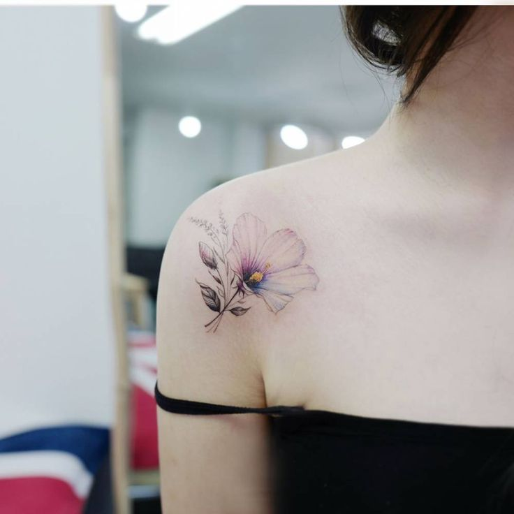 Hibiscus flower tattoo on the right shoulder.