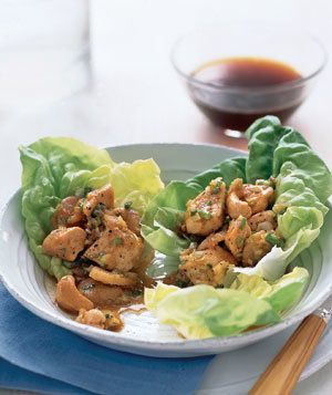 Chicken and Cashews in Lettuce Wraps | On the table in 20 minutes flat, these ginger- and garlic-spiced lettuce wraps make for a light but satisfying supper. High in protein and low in carbs, the dish comes together in one sauté pan. Simply cook the chicken and sprinkle the filling over Boston or Bibb lettuce leaves; the wrap, combined with water chestnuts and cashews (sprinkled on at the very last minute), provide plenty of crunch. Wondering if the kids will raise an eyebrow at the…