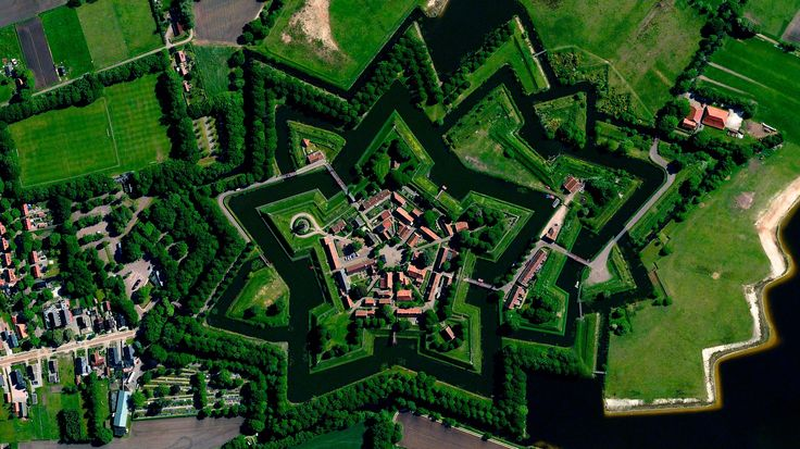 "6/9/2015 Bourtange star fort Bourtange, Netherlands 53.0066°N 7.1920°E   Bourtange is a ""star fort"" built in 1593 during the Eighty Years' War when William I of Orange wanted to control the only road between Germany and the city of Groningen. Star forts were constructed in the manner you see here so that an attack on any of its five walls could be aggressively counteracted from the two adjacent star points."