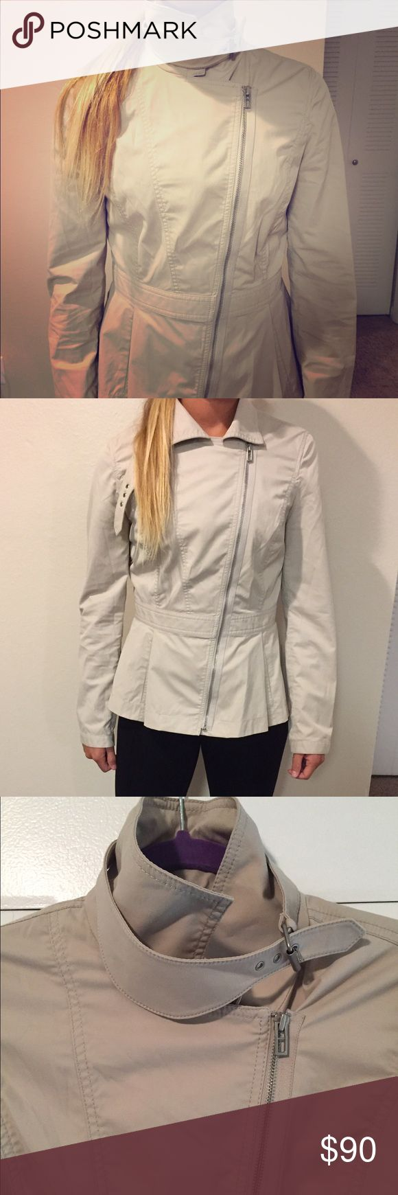 Armani Exchange jacket Light weight beige jacket. Hardly ever worn. Such a nice shape with the pleats. Zipper works perfectly. The neck line has such a high fashion look. Perfect with jeans or leggings, heels or boots! Armani Exchange Jackets & Coats