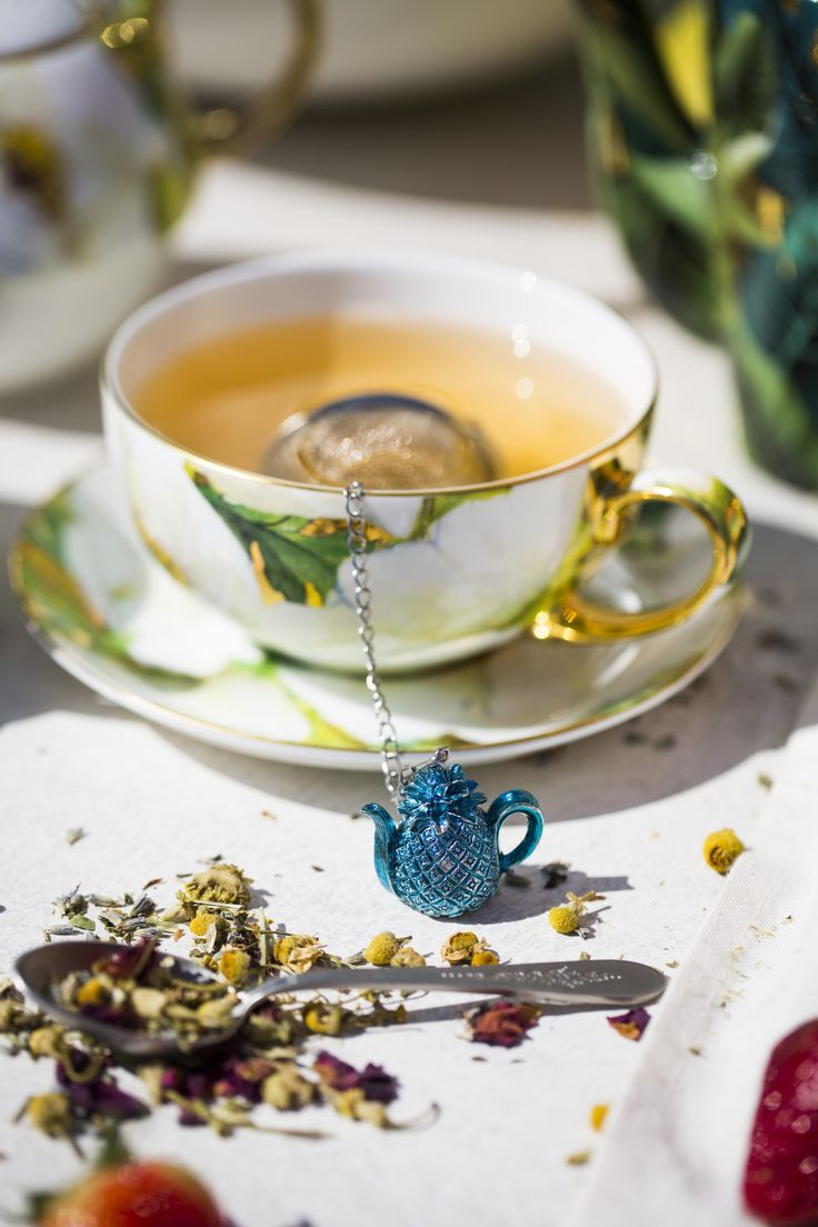 Can I sip it? Leaf it to me! Luscious teacup and saucer set with metallic pineapple infuser