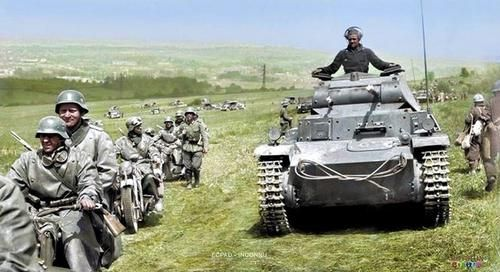 Sedan, northern France - A Panzer II (PzKpfw II) of the 10th Panzer Division, along with motorcycle troops and infantry during the battle at Sedan, northern France; May 1940. The German army invaded neutral Belgium and crossed the Meuse River in Sedan. This allowed them to get past the French fortification system, called the Maginot Line.