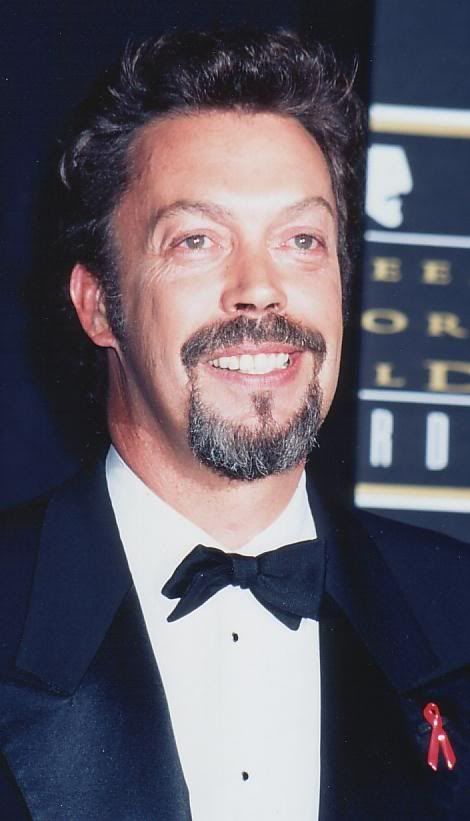 Tim Curry/ Always plays the quirky roles well!!!  Yes, he is gay - but he's very versatile & talented.   He is usually intensely private regarding his personal life, which is why you don't see pix of him with his lovers (male or female). He's got a wonderful voice, is a great actor. I've been a fan for many many years & try to catch all of his work.