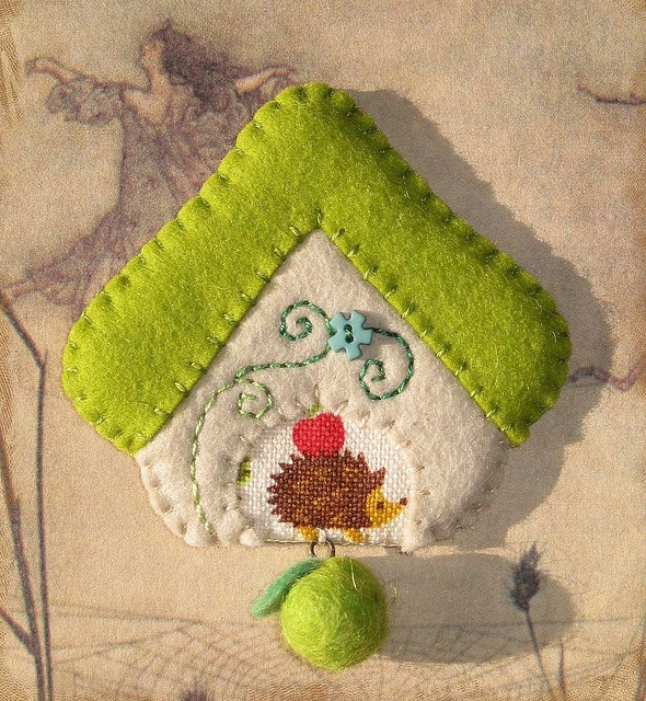 Adorable felt and cross stitched ornament.