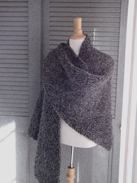 This easy shawl is all one stitch, so it's easy to knit while watching a movie or your favorite show! Make it with Lion Brand Homespun!