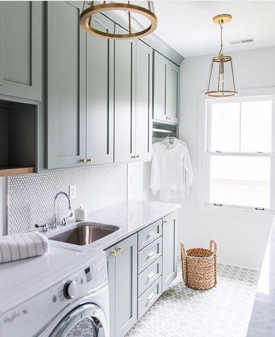 laundry room with brass pendants and hardware