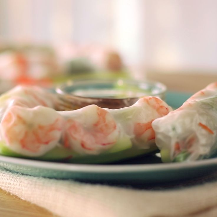 A light and refreshing snack or meal, these shrimp spring rolls w/ a spicy peanut sauce are super delicious and easy to make!