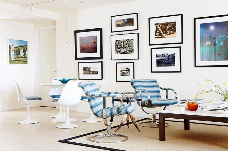 Our horn table sits between a pair of vintage chairs in this condo by Sarah Richardson! Photography by Stacey Brandford.