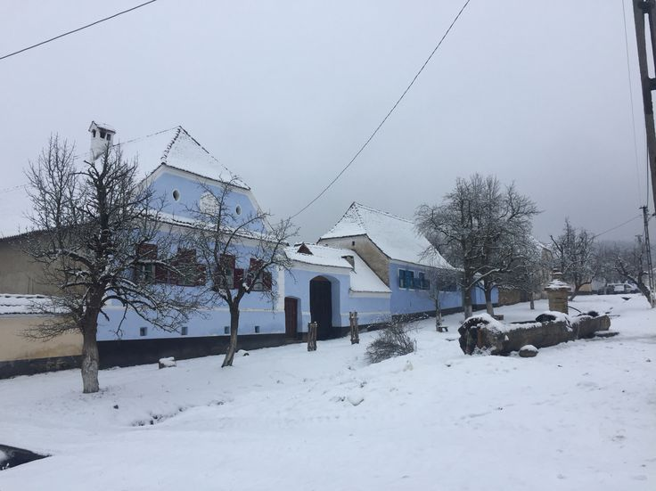 fresh snow on the main road in Viscri village, Transylvania