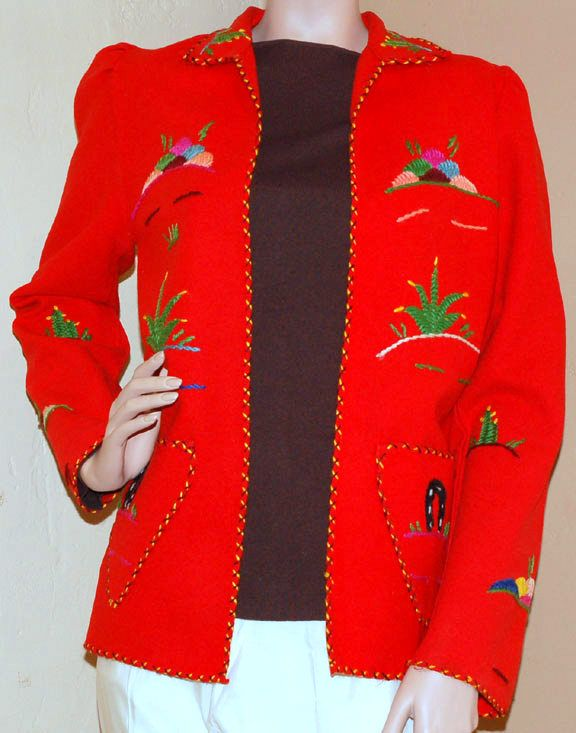 This vintage tourist jacket is darling in bright red wool felt jacket with all-over multi-color yarn embroidery in a Mexican theme motif. $145 luckystargallery.com