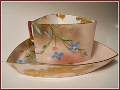 PLEASE LOOK AT MY OTHER AUCTIONS FOR MORE HAND PAINTED LIMOGES Up for auction is a gorgeous Rare and Unusual Pouyat Hand Painted Limoges Cup & Saucer. The triangular cup and saucer is beautifully deco