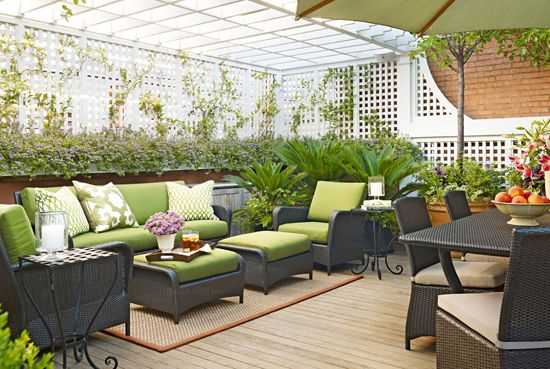 Clean-lined furniture keeps it contemporary in this rooftop garden - Traditional Home®