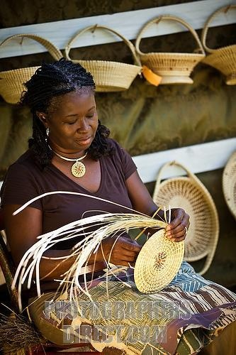 Sweet grass basket weaver.  I have one of these baskets, they are just beautiful and made with love and skill.