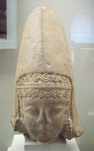 Iberian female head. Cabeza femenina ibera. Date between 300 and 100 BC Medium limestone Dimensions Height: 33 cm (13 in). Width: 20 cm (7.9 in). Depth: 18 cm (7.1 in). Current location National Archaeological Museum of Spain From Archaeological Site Cerro de los Santos