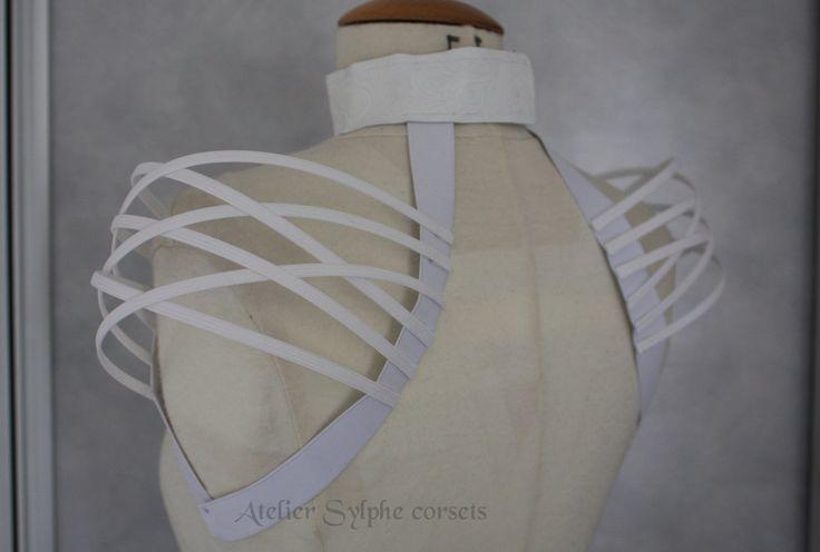 White neck collar and fantasy shoulders boned crinoline.