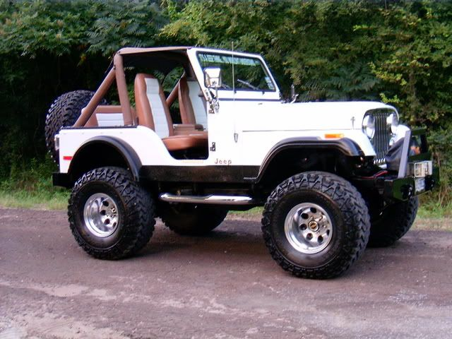 1977 Jeep CJ5. My first vehicle was one of these in gunmetal grey, with 35 inch Super Swampers