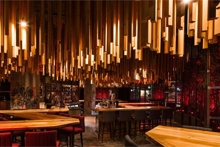 Design firm Jean de Lessard - Designers Créatifs have recently completed Ganadara, a new restaurant in Montreal, Canada, that features 2,700 wood lengths that hang from the ceiling. #RestaurantDesign #Wood #WoodCeiling #ModernRestaurant